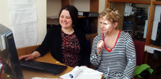 Gillian helping a participant in our research library